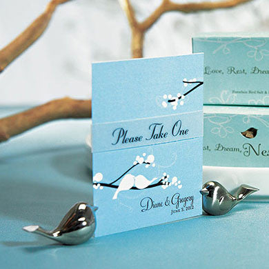 A set of Love Bird Card Holders holding a place card.