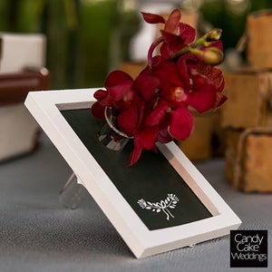 Mini Framed Chalkboard Wedding Favor with a red flower (not included).