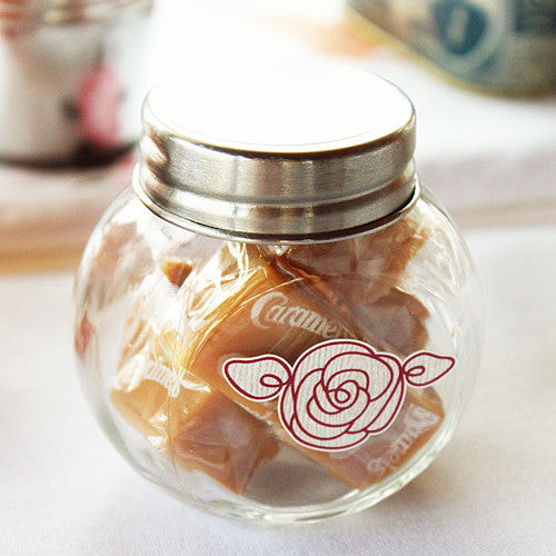 Mini Glass Jars filled with caramels and decorated with a flower sticker (caramels and sticker not included.).