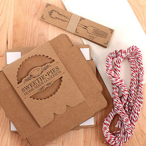 The Mini-Pie Wrapping Kit for Wedding Favors, includes pie boxes, pre-cut twine, tags, and wax sheets.