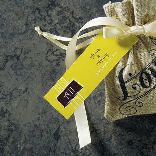 The Rectangular Personalized Modern Medley Wedding Favor Tag attached to the Mini Linen Drawstring Pouch.