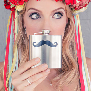 A bridesmaid holding up a flask with a mustache on it, cute photo idea.