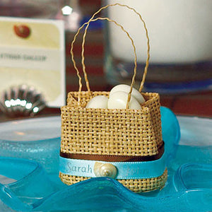 Mini Woven Wedding Favor Beach Bag filled with seashells.