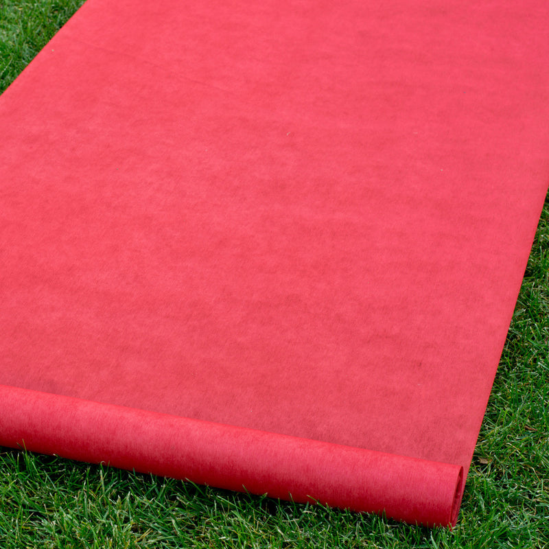 Red Wedding Aisle Runner on top of grass.
