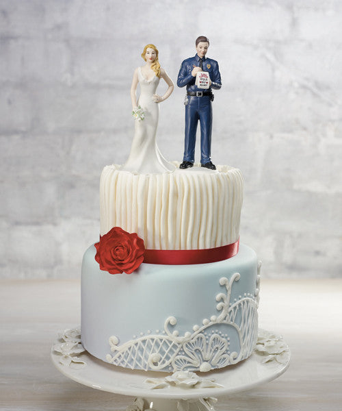 Wedding Cake Top - Policeman Groom Figurine giving the bride a Love Ticket.