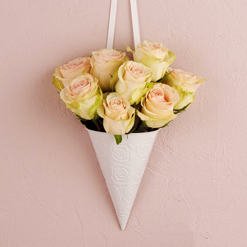 Decorative White Metal Cone with Rose Pattern used for weddings and parties.