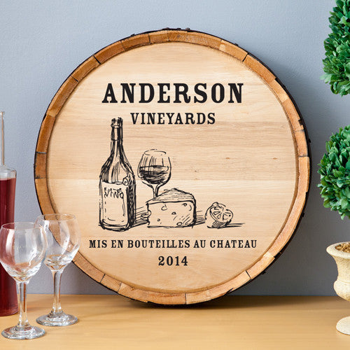 Personalized with family name and date, the Wine & Cheese Oak Wine Barrel Sign.
