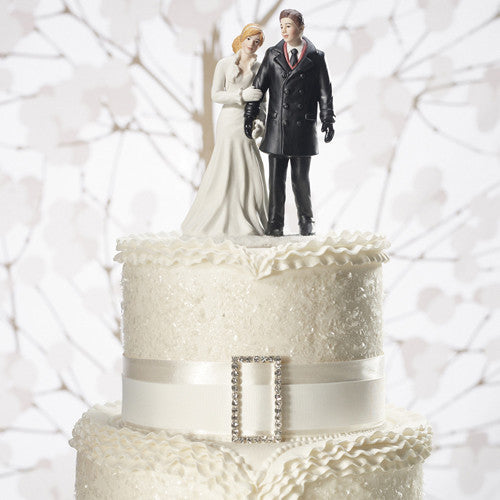 Winter wonderland wedding couple figurine on top of a white cake.