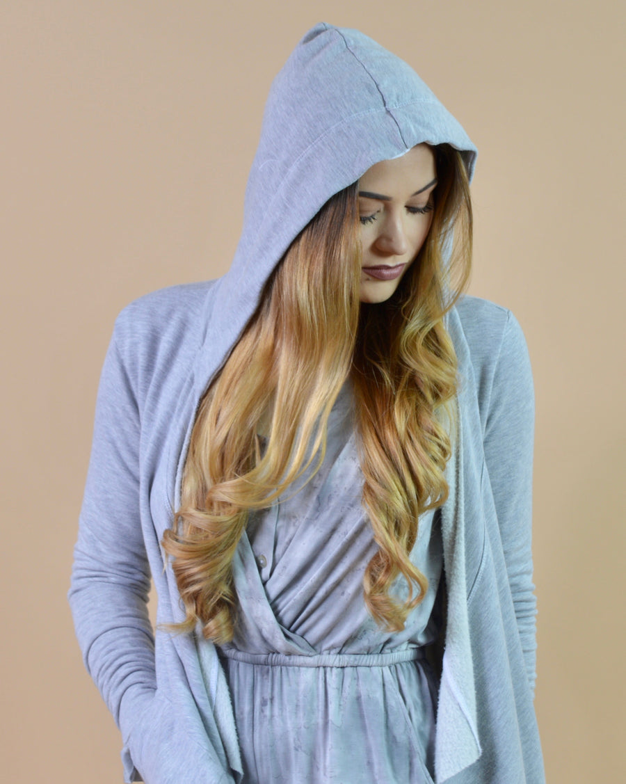 Cute ,lightweight shawl is the definition of cozy. Produced in an eco-friendly, closed loop process. This long sleeve, hooded shawl is made with bamboo and Wool