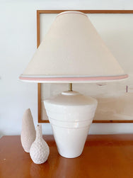 Ceramic lamp with pink detailing