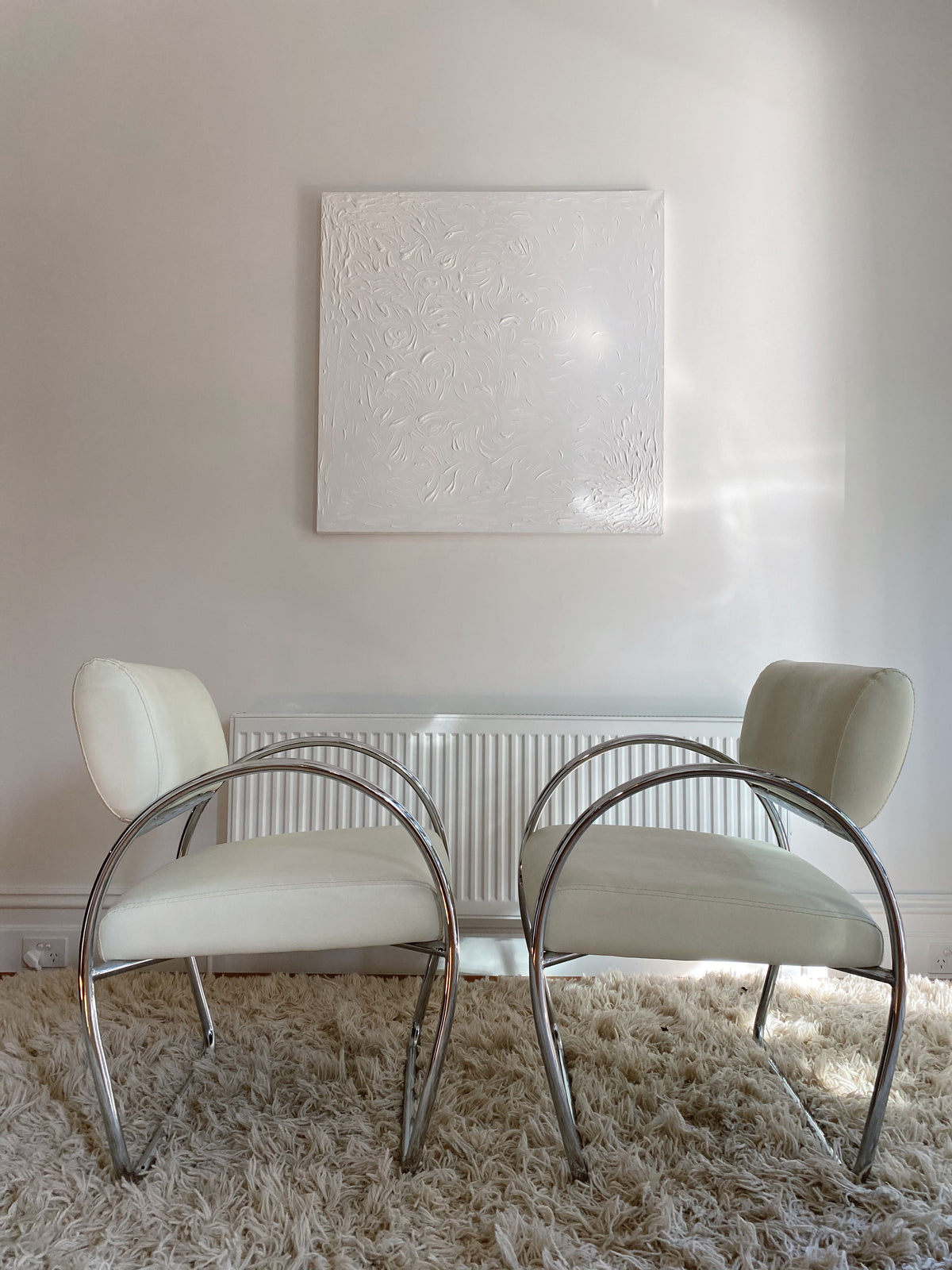 White Chrome and Leather Armchairs