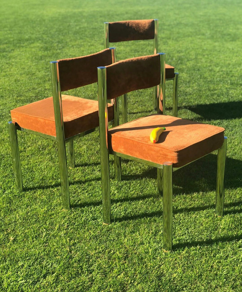 Four Velvet and Chrome Dining Chairs