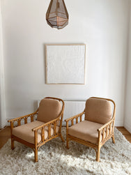 Boucle and Cane Lounge Chairs
