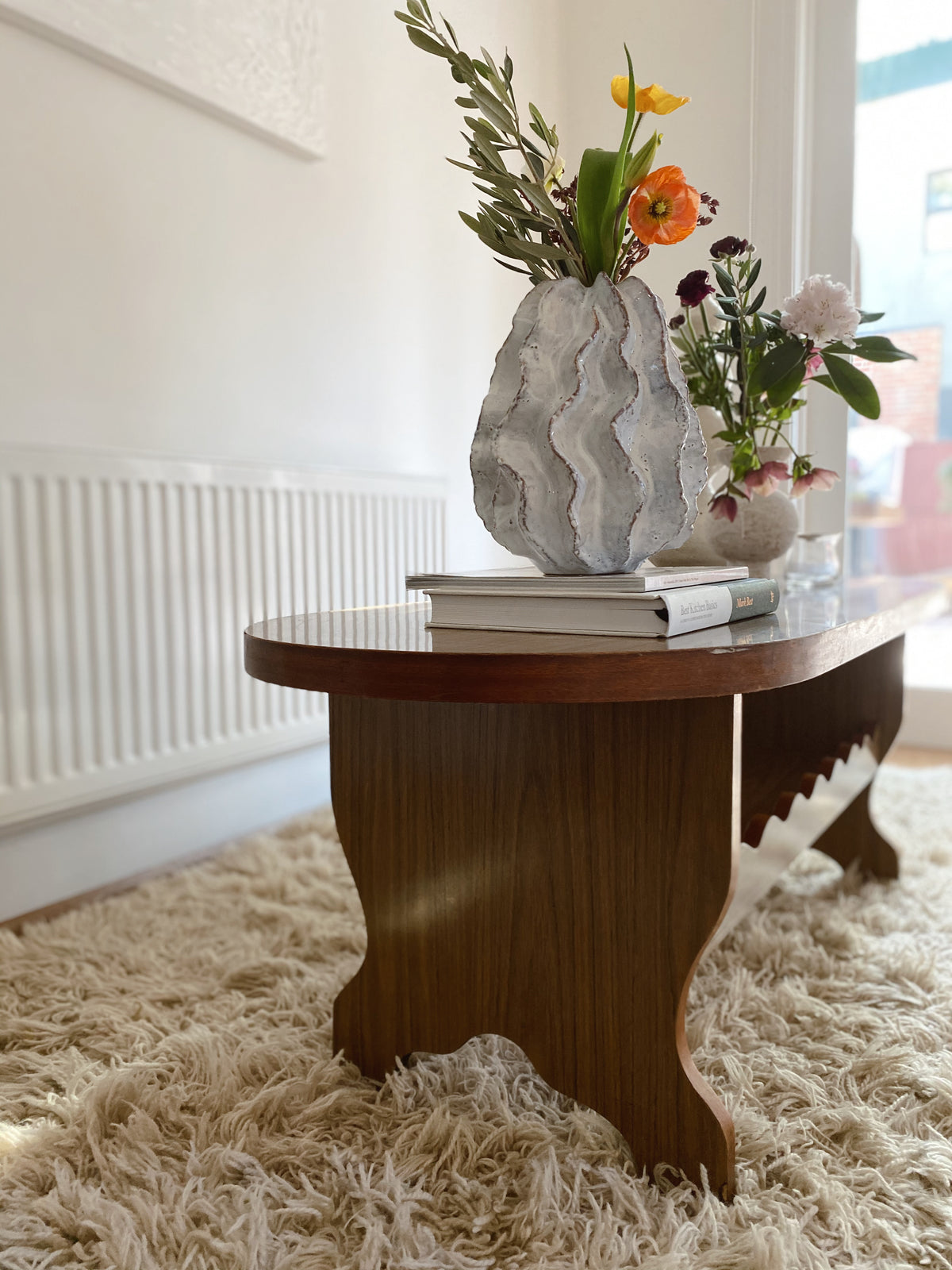 Oval Coffee Table with Curvy Detailing