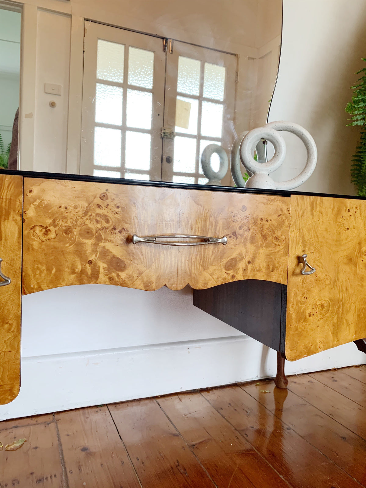 Lowline dresser with gloss black glass