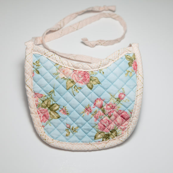 Bespoke Baobei's Georgie quilted bib with floral print and gingham trim, front.