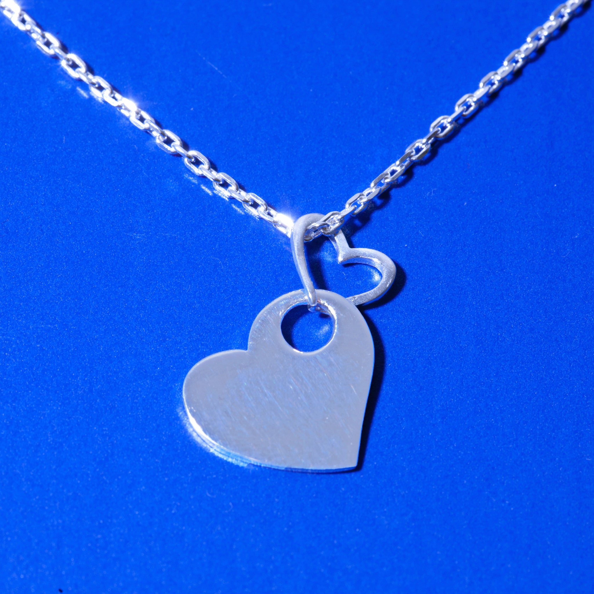 DOUBLE FLOATING HEART PENDANT