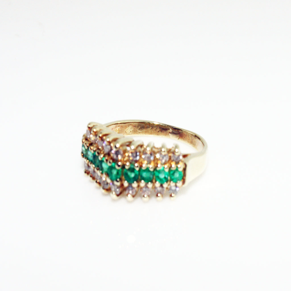 ROUND DIAMOND AND EMERALD RING