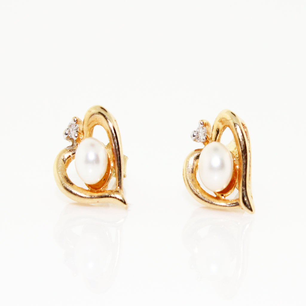 HEARTS OF PEARL STUDS