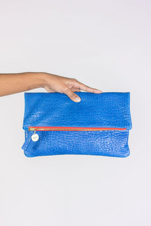 Clare Vivier Foldover Clutch in Blue Pebble with Red Zipper
