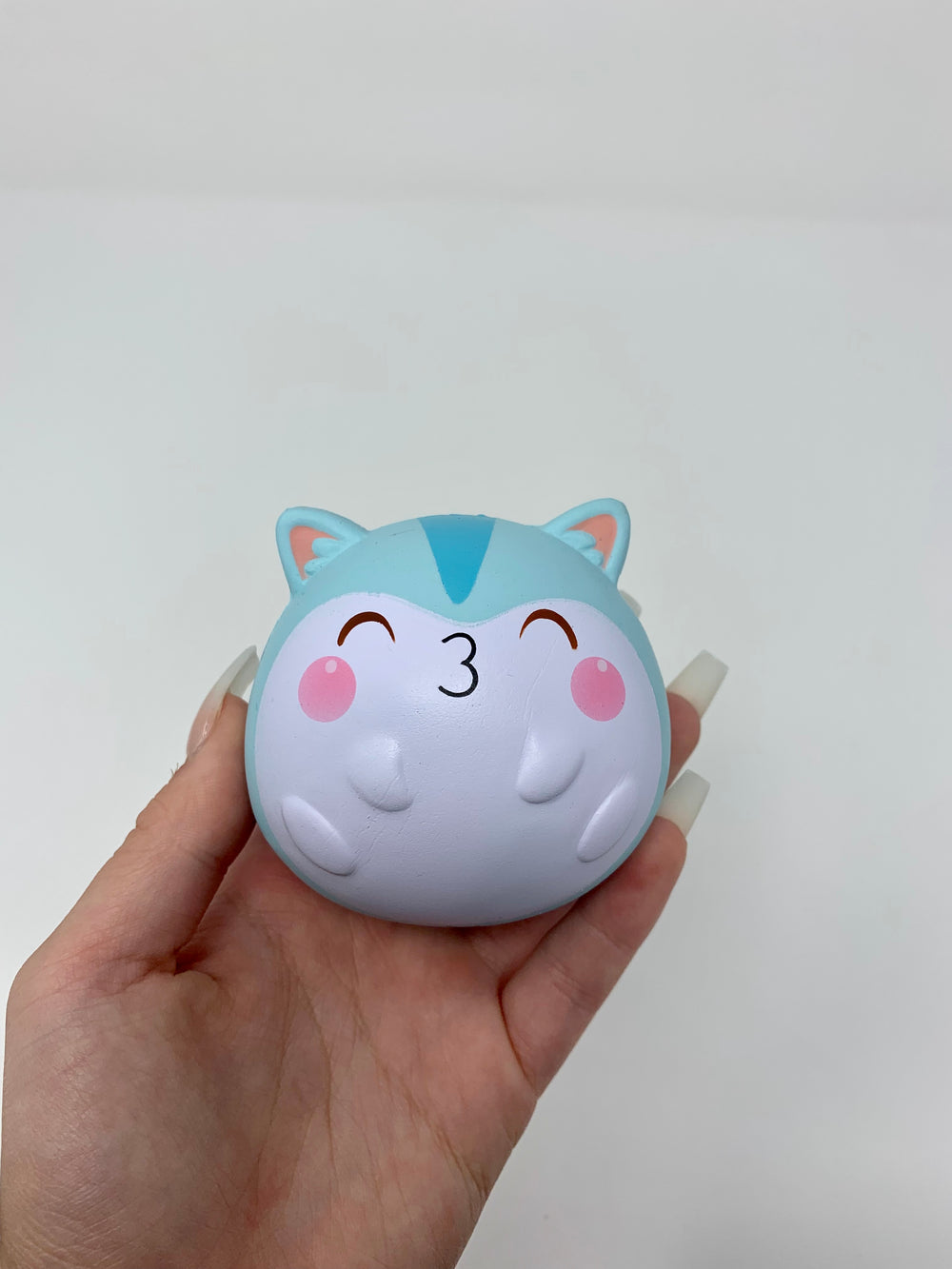 Mini Baby Poli Fat Fat Squishy blue version held in hand