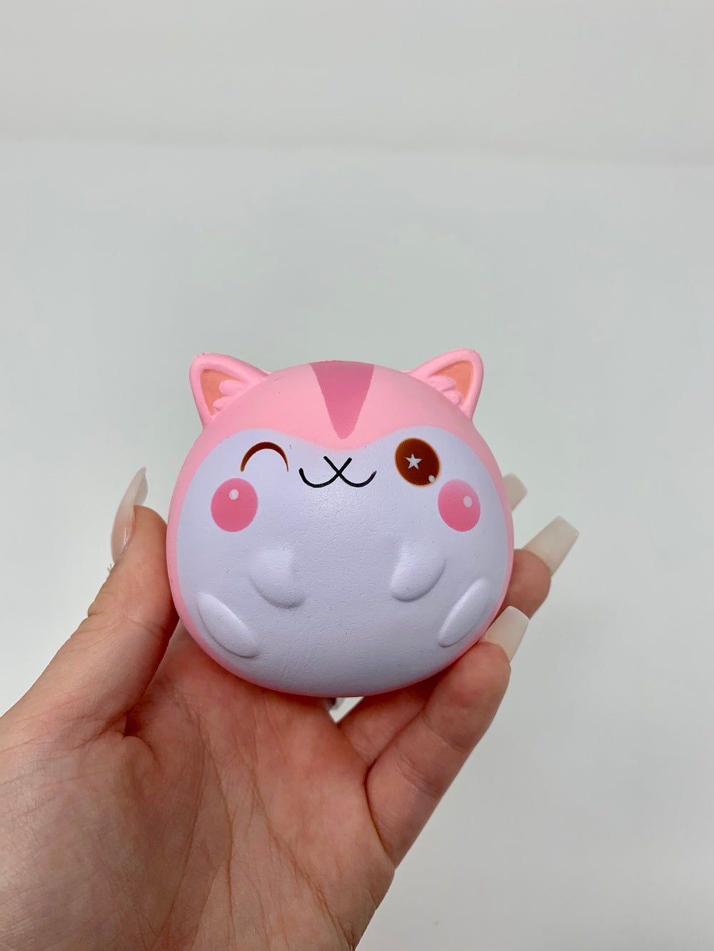 Mini Baby Poli Fat Fat Squishy pink version held in hand