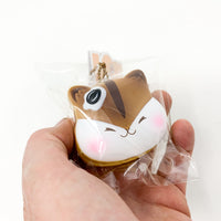 Poli Mini Pancake Squishy by Popularboxes Chocolate version held in hand