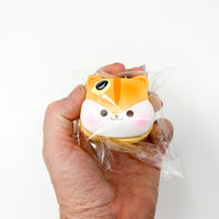 Poli Mini Pancake Squishy by Popularboxes Plain version held in hand