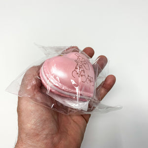 Poli New Big Heart Macaron Squishy pink version held in hand