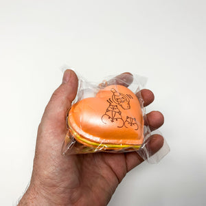 Poli New Big Heart Macaron Squishy orange version held in hand