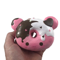 Marshmellii Piggy Donut Squishy Boy front view held in hand