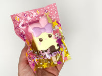 iBloom Angel Bunny Ice Candy Squishy Lulu versions in packaging held in hand
