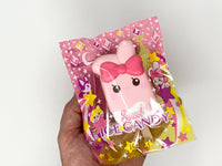 iBloom Angel Bunny Ice Candy Squishy Marie versions in packaging held in hand