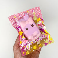 iBloom Angel Bunny Ice Candy Squishy Charlotte versions in packaging held in hand