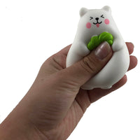 IBloom Mini Marshmallow Bear Squishy pink strawberry tongue version front view held in hand squished