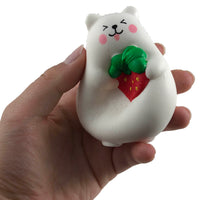 IBloom Mini Marshmallow Bear Squishy Red strawberry tongue version front view held in hand squished