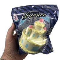 Cafe De N Elegance Castle Cake Yellow front view in packaging held in hand
