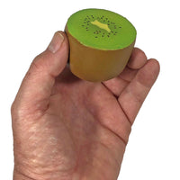 Puni Maru Mini Kiwi Green version side view held in hand