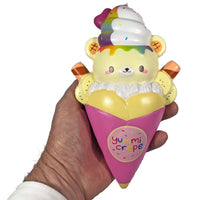Creamiicandy Yummii Crepe Squishy rainbow version front view in hand