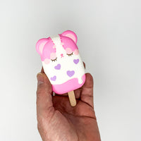 iBloom Harajuku Bear Ice Candy Squishy pink version front view held in hand