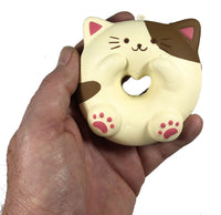 Cafe Sakura Cat Donut Squishy brown and white cat front view held in hand