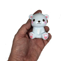 Puni Maru's Mini Happy Polar Bear Squishy Blue Smile Version front view in hand