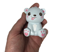 Puni Maru's Mini Happy Polar Bear Squishy Blue Tongue Version front view in hand