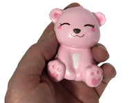 Puni Maru's Mini Happy Polar Bear Squishy Pink Smile Version front view in hand