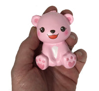 Puni Maru's Mini Happy Polar Bear Squishy Pink Open Mouth Version front view in hand