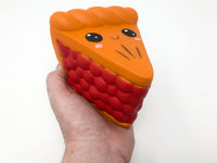 Berry Pie Squishy with Smiling Face top view held in hand