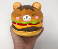 Big Yummiiburger Squishy closed eyes version front view held in hand