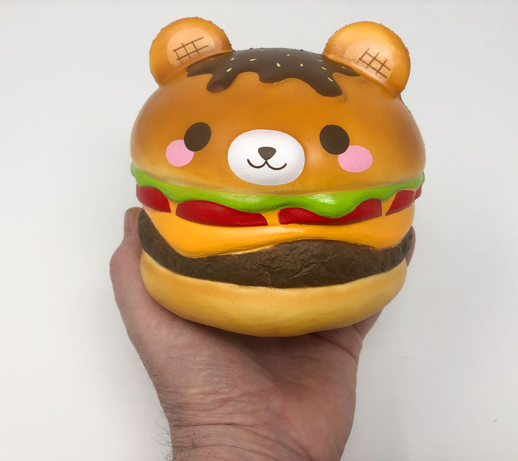 Big Yummiiburger Squishy open eyes version front view  held in hand
