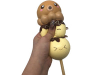 Puni Maru Animal Dango Series Squishy Octopus version front view held in hand being squished