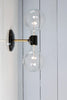 Brass and Black Bare Bulb Sconce Light